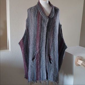 Never worn Free people poncho